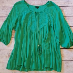 Green tunic top with crochet detail on fronr/back